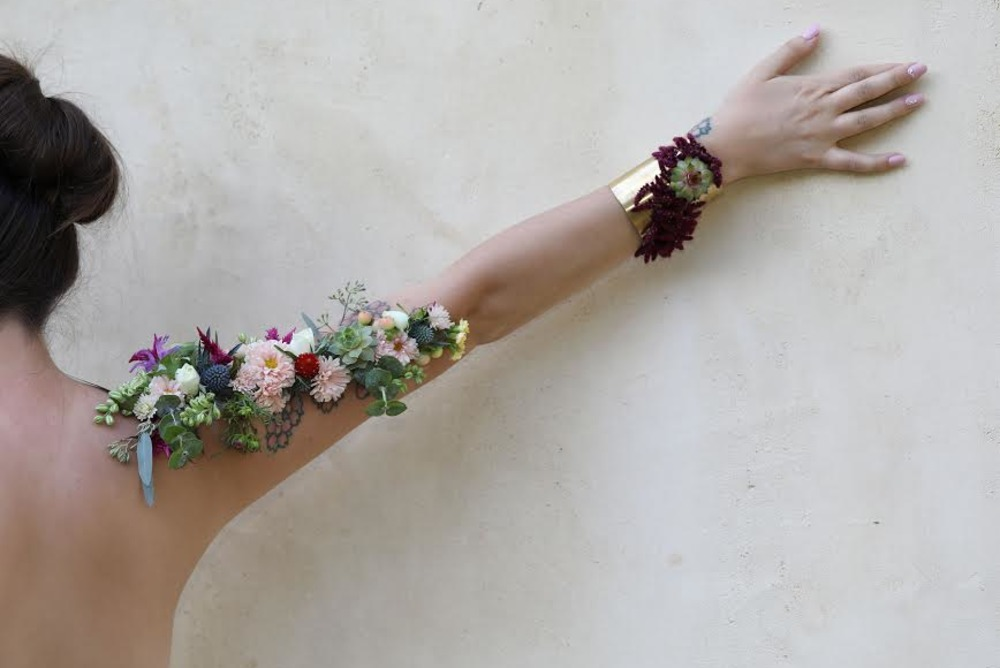 women with flowers on the hand