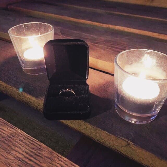 wedding ring and candles