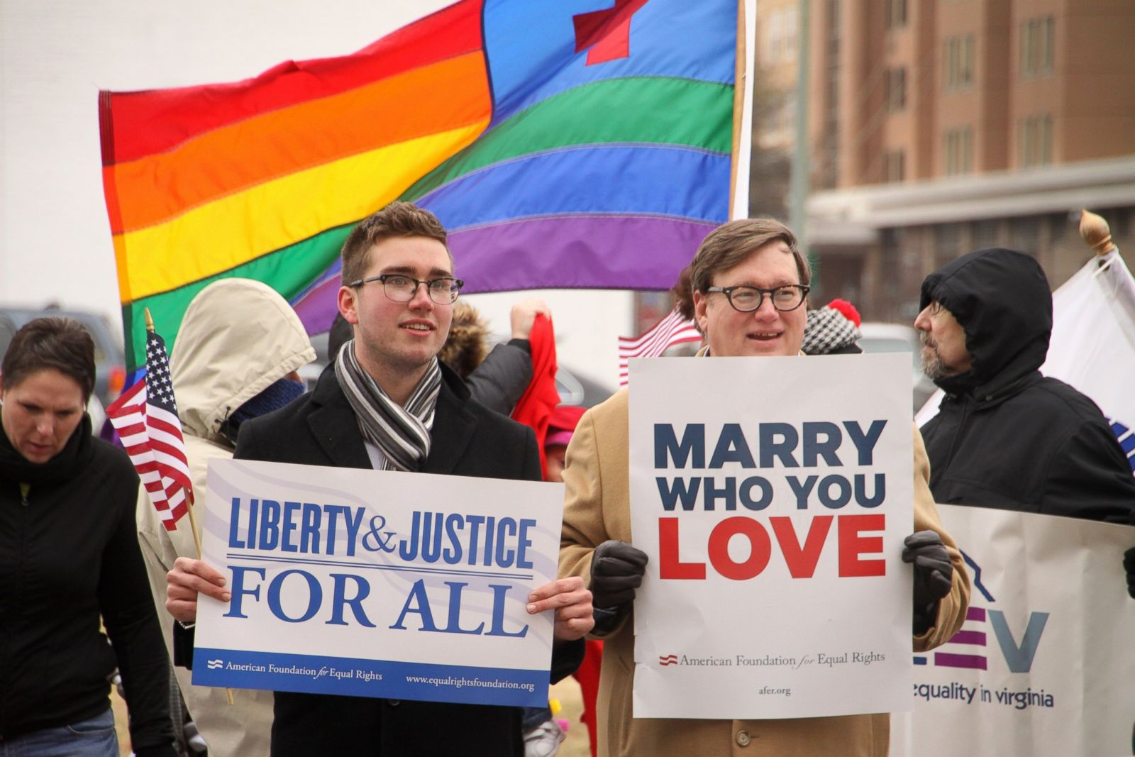 Two men staying with posters about Marriage Rights for LGBTQ couples