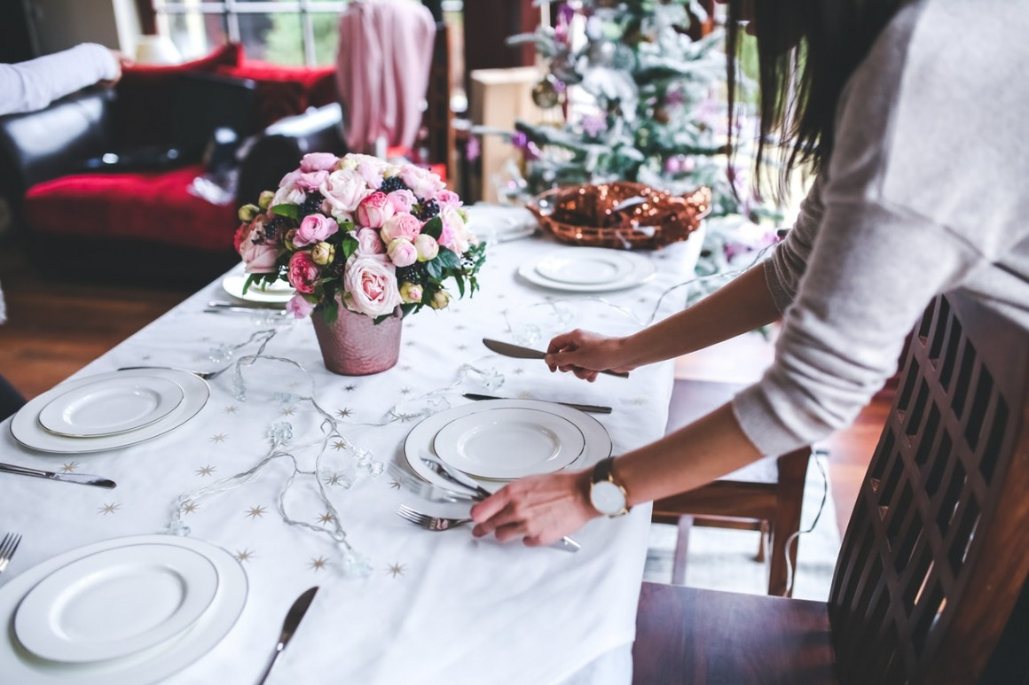 Wedding planner decorate a table