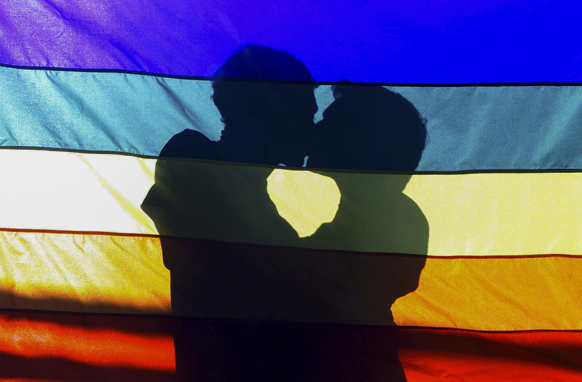Rainbow flag, two men kissing